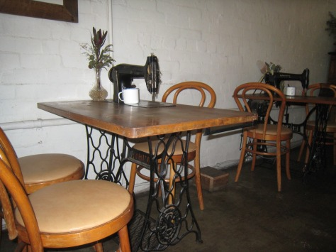 Brekky 2=of-2 shows the Singer sewing tables that hung around this old building and now are your dining tables at Captains of Industry.