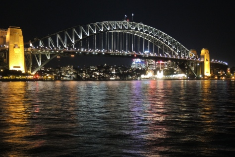 The massive Sydney Harbor Bridge with no support on the water is perfect for the endless boat traffic that passes beneath it daily