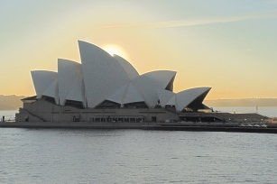 Sunrise sets the Sydney Opera House aglow.