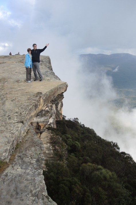 "Hey ""Mista,"" is that a rock ledge in the clouds at a location called Kings Tablelands in the Blue Mountains outside Sydney? Was it safe? Sure! ... It would have been poor taste for her to push him over the edge on their anniversary."