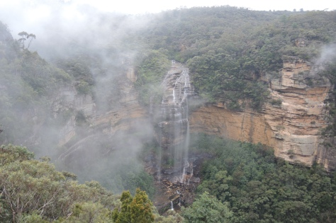 "We dedicate this photo to Erin. We met her the night before, and she said we should see Wentworth Falls in the Blue Mountains. It wasn't on the itinerary, but when all other views were shrouded in mystery, we had our guide take us here for the only decent scenery captured on ""film"" this day."