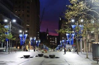 Distant sunset down the Martin Place pedestrian mall frocked with flags from the ANZAC (Veteran's Day) commemoration on this site the prior day. Let's pretend that's a crescent moon in the middle and not a portion of the clock face on the tower.