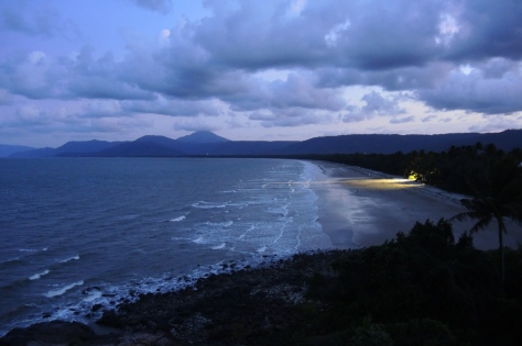 Four mile beach in Port Douglas faces east with evening spotlights on the swimming area soon after the sun has set.