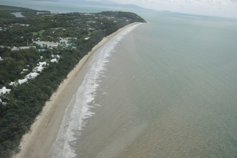 Our pilot Ryan obliges the request for a view of Four Mile Beach from the air. Our Port Douglas hotel is at the far (North) end.