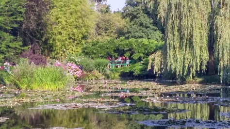 Monet's green Japanese arched bridge is featured in many paintings and distant in this photo