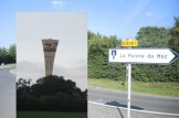 Pointe du Hoc signpost and Viking-décor Normandy water tower