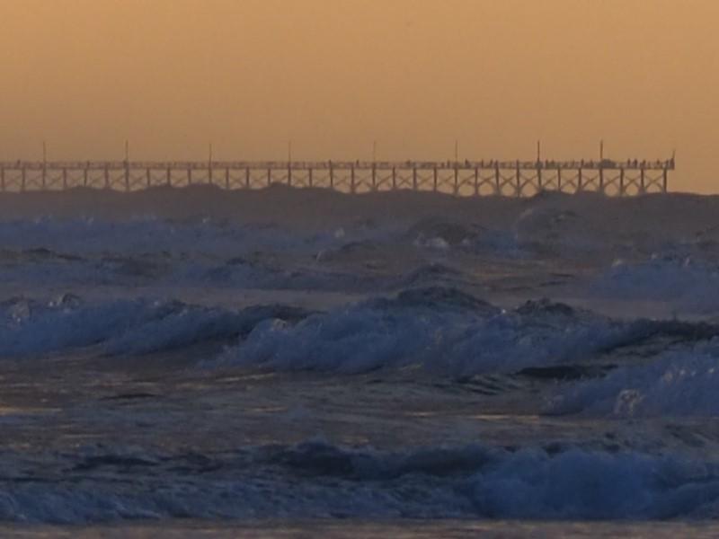 Alt: Distant pier fishermen